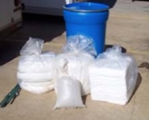 Spill Kit with Sorbent Boom, Pads, and Sandbag filled with Oil Dry
